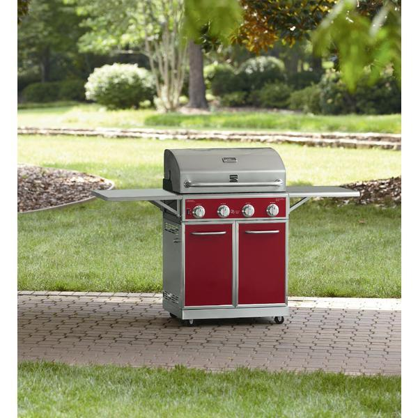 Kenmore Red 4 Burner Gas Grill With Folding Side Shelves and lit knobs